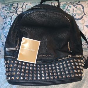 black studded Michael kors back pack